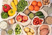 Zero waste concept. Fruits and vegetables in eco friendly reusable bags