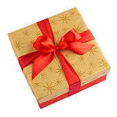Red gift or present box with golden colored top and red ribbon bow isolated on white background