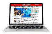 Sample news website shown on laptop
