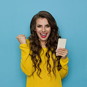 Beautiful Young Woman Is Holding Telephone And Laughing