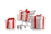 Christmas shopping. Trolley cart for supermarket with christmas or birthday gift box isolated on white background. Sale buy mall market shop consumer concept. Copy space.