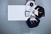 Group of business people analyzing financial documents, view from above. Business team at meeting