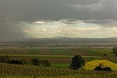 Strom gathering over vinicultural landscape