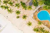 Tourist resort with beach, hut, palm trees and swimming pool, Zanzibar, Tanzania