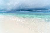 Landscape with sandy beach and blue water in sea,  Zanzibar,  Tanzania