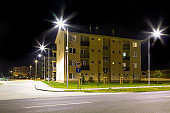 apartment building with modern LED street lights