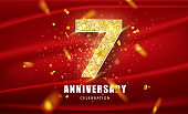 7 Golden glitter numbers and Anniversary Celebration text with golden confetti on red background. Seventh anniversary celebration event vector template.