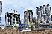 View of the larger construction site. Construction of multi-storey residential buildings