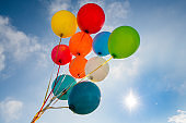 Colorful cluster of balloons in the sky