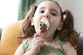 Cute girl eating ice cream