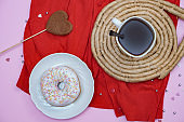 Beautiful juicy donuts with coffee in plates on a decorative tray. February valentine's day greeting card. background for kitchen design
