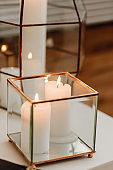 Burning Candles in Decorative Glass Box Closeup