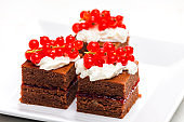 chocolate cakes with redcurrant and cream