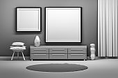 Black and white room interior with two picture frames