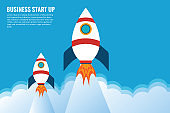Business project startup, financial planning, idea development process, strategy, management, realization and success. Rocket launch on the clouds and blue sky