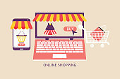 Online shopping concept with open laptop and smartphone