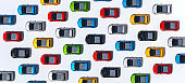Multiple Colored Solar Powered City Cars Isolated Against White, Directly Above View. knolling concept