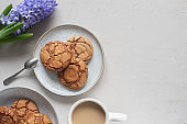 Chocolate fudge cookies and a cup of coffee with milk