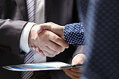 Professional document agreement in conference room