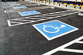Multiple parking spaces reserved for disabled shoppers in retail parking lots.