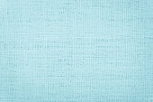 Pastel Blue abstract Hessian or sackcloth fabric or hemp sack texture background. Wallpaper of artistic wale linen canvas. Blanket or Curtain of cotton pattern with copy space for text decoration.