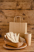 Zero waste tableware set for picnic on wooden background. Environmental consiousness concept.