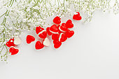 Greeting card concept. Heart shaped jelly gummies on white. Copy space. Love and romance. Top view, overhead