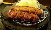Japanese food, pork cutlet served on a black plate