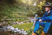 Adventure boy resting in nature