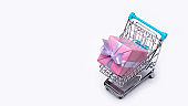 Gift boxes in pink packaging, in a shopping cart.