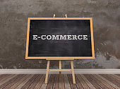 Easel with E-COMMERCE Word on Chalkboard Frame - 3D Rendering