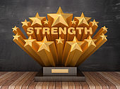 Gold Stars with STRENGTH Word  on Trophy - Chalkboard Background - 3D Rendering