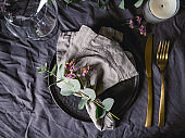 Festive table setting with floral decor. The concept of Thanksgiving or wedding dinner.