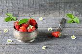 A ripe strawberry in bowl.