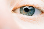 Extreme close-up of blue eyes