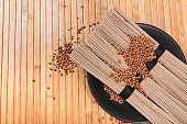Buckwheat noodles closeup. Raw food ingredient. Dried buckwheat soba noodles. Traditional Japanese food