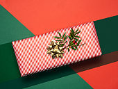 Close-up of gift box with twig and golden ribbon