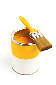 Can with yellow paint with brush isolated on white background - Image