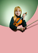 Beautiful young female musician holding her string instrument