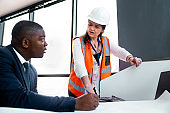 Businessman discussing over plan with engineer