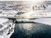 Beautiful view of a bridge over a river on a sunny winter's day