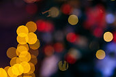 Colorful Red, Yellow and Green Christmas Tree Bokeh background of de focused glittering lights, Christmas background pattern concept.