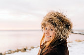 Close-up portrait of smiling woman wearing fur hat