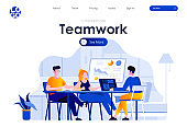 Teamwork flat landing page design. Colleagues sitting at desk and discussing ideas or brainstorming scene with header.