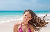 European woman enjoying the caribbean beach