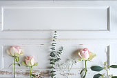 Floristry on white vintage wooden background_