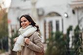 Autumn season, girl walking around the city.