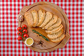 Italian Appetizer. Chiabbata and sliced white bread on wooden boards. Country style. Baguette bread path with branch cherry tomato, olive oil, garlic. Italy food. Close up.