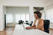 Smiling businesswoman wearing headset talking to a client, portrait, copy space.