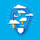 Lightning lamp. Clouds. Light bulb in paper craft style. Origami Electric bulb for creativity, startup, brainstorming, business. Blue background.